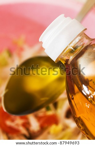 vegetable oil for a salad in a spoon - stock photo