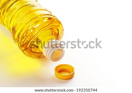 Vegetable oil in plastic bottle on white background - stock photo