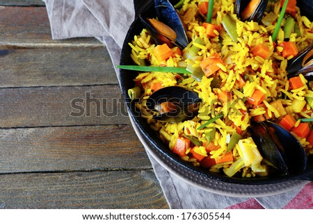 Vegetable paella with seafood, top view, food closeup - stock photo