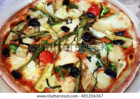 Vegetable pizza on the dinner plate.