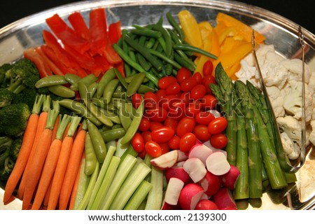 Vegetable Platter with carrots, celery, cherry tomatoes, asparagus, cauliflower, radishes, broccoli, snow peas, red bellpepper, yellow bellpepper, and green beans