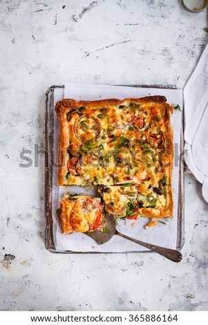 Vegetable Quiche puff pastry homemade preparing. Rustic style. - stock photo