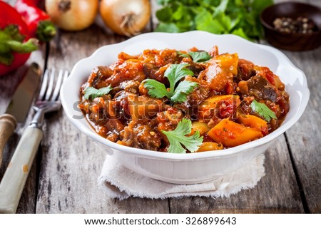 vegetable ragout (ratatouille) paprika, eggplant and tomato on wooden table
