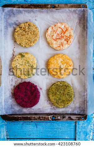 Vegetable raw cutlets burger recipe. Beetroot, chickpeas, bulgur, quinoa, sweet potatoes, green veggies fresh burger ready to prepare on bbq. Vegetarian or diet food concept. Top view. Copy space. - stock photo