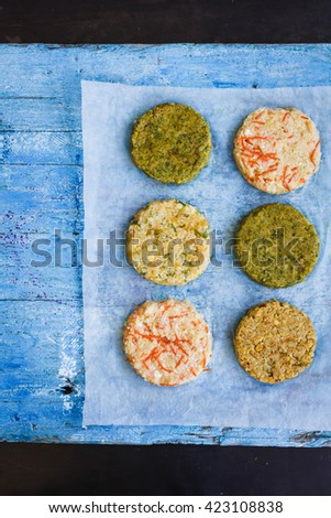 Vegetable raw cutlets burger recipe. Beetroot, chickpeas, bulgur, quinoa, sweet potatoes, green veggies fresh burger ready to prepare on bbq. Vegetarian, diet food concept. Top view. Copy space. - stock photo