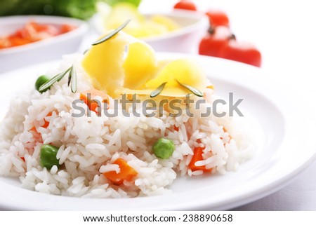 Vegetable rice served on table, close-up - stock photo
