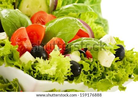 Vegetable salad bowl isolated on white - stock photo