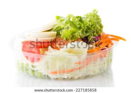 Vegetable salad bowl isolated on white. - stock photo