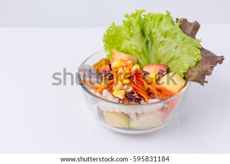 Vegetable salad bowl isolated on white background.