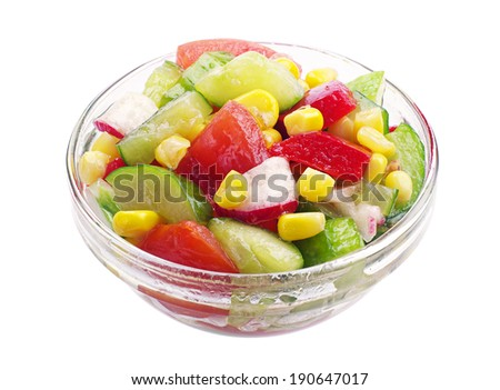 Vegetable salad in a small glass bowl isolated on white background
