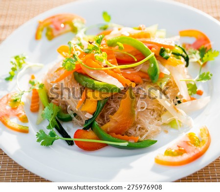 Vegetable salad on a white plate. Restaurant