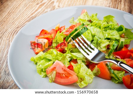 Vegetable salad on the wooden table