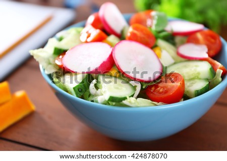 Vegetable salad on wooden table closeup