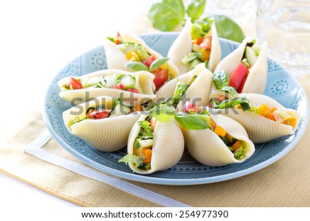 Vegetable salad served in jumbo pasta shells - stock photo