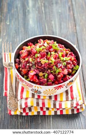 Vegetable salad vinaigrette of beets, pickles, sauerkraut, potatoes, green peas and lentils. Russian traditional cuisine - stock photo