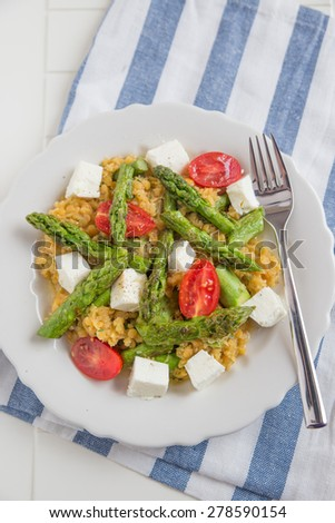 Vegetable salad with asparagus and red lentils