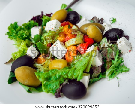 Vegetable salad with black and green olives. Restaurant