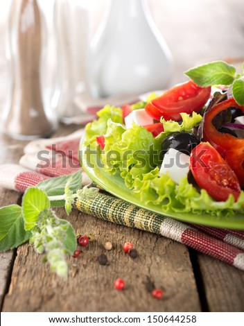 Vegetable salad with feta cheese and mint - stock photo