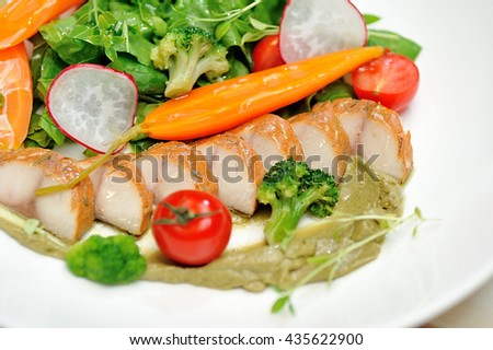 Vegetable salad with fish and avocado cream