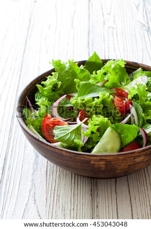 Vegetable Salad With Fresh Lettuce Tomatoes And Cuber In Clay Pot