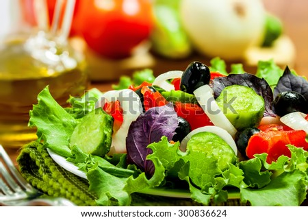 Vegetable salad with ingredients, close-up
