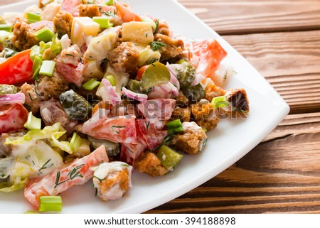 vegetable salad with mayonnaise in white plate closeup
