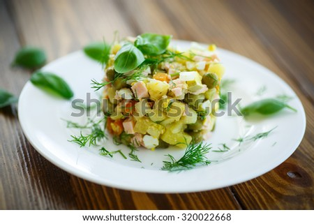 vegetable salad with pickled cucumbers and greens - stock photo
