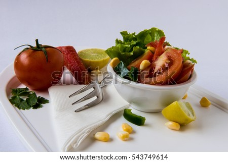 Vegetable Salad with Tomato, carrot, corn and lemon