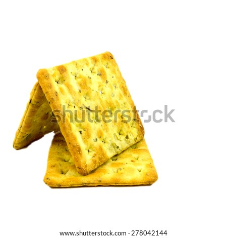 Vegetable salty crackers on white background.