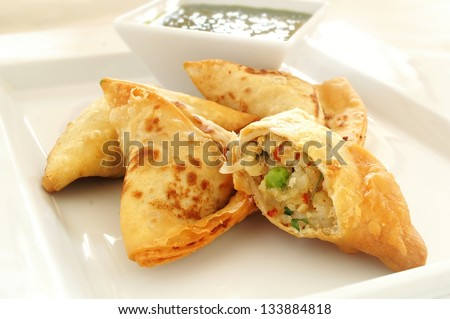 vegetable samosas with riata dip - stock photo