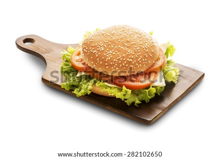 vegetable sandwich on the wooden table with a glass of beer - stock photo