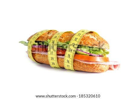Vegetable Sandwich wrapped in measure tape  in diet , weight loss and healthy nutrition concept isolated on white background - stock photo