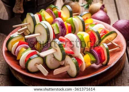 Vegetable skewers prepared for baking. Selective focus. - stock photo