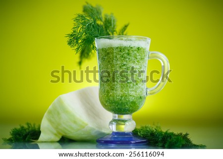vegetable smoothie cabbage with dill on a green background - stock photo
