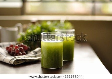 Vegetable Smoothie with coriander in background - stock photo