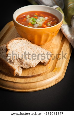 Vegetable soup bowl with bread
