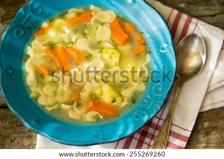 vegetable soup in a cup on a wooden rustic background - stock photo