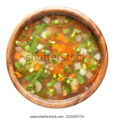 vegetable soup in wooden bowl. top view - stock photo