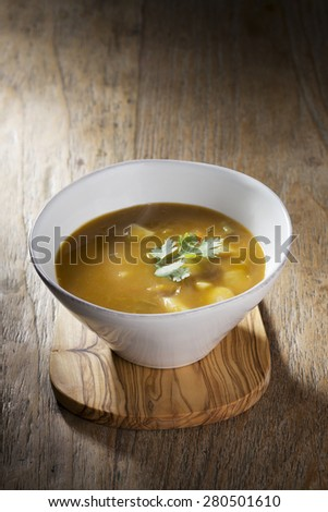 Vegetable soup on a wooden table. Rustic and wholesome homemade vegetable stew. - stock photo
