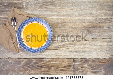Vegetable soup on the wooden background. Rustic style - stock photo