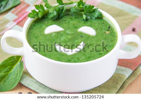 Vegetable soup with a smiling face - stock photo