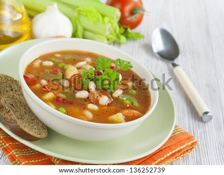 Vegetable soup with beans and celery on the table