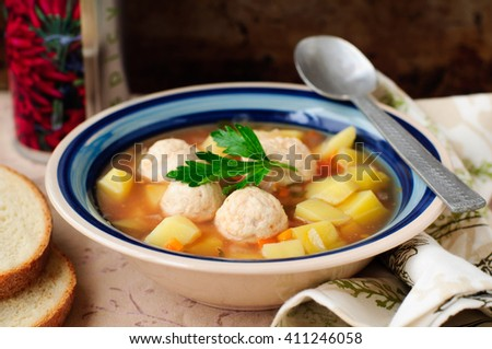 Vegetable Soup with Chicken Meatballs in a Deep Plate - stock photo