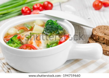 Vegetable soup with chicken white ceramic bowl - stock photo