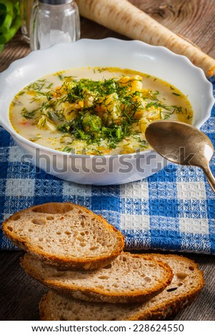 Vegetable soup with ingredients on a wooden table. - stock photo