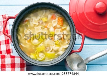 vegetable soup with pasta in pot - stock photo