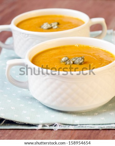 Vegetable soup with pumpkin seeds, selective focus