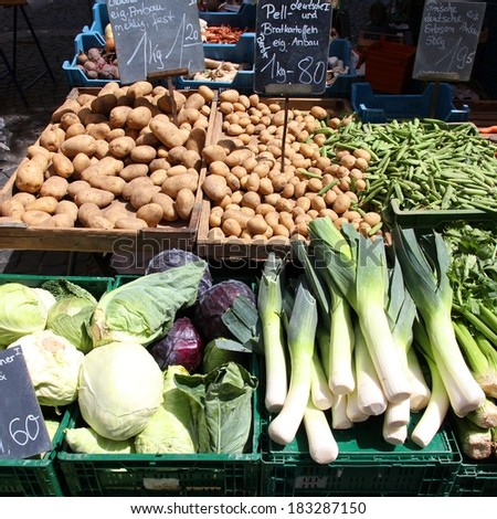 Vegetable stand at a marketplace in Mainz, Germany. Farmers market. Square composition. - stock photo