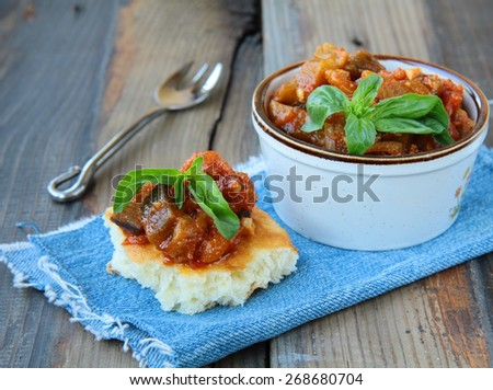 vegetable stew of eggplant and tomatoes, served with fresh tortilla - stock photo