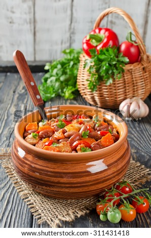 Vegetable stew with chicken and beans. Rustic style
